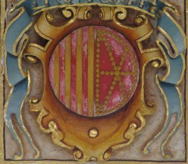 Wie heißt der 'Chef' des Gebäudes, in dem sich dieses Wappen befindet?